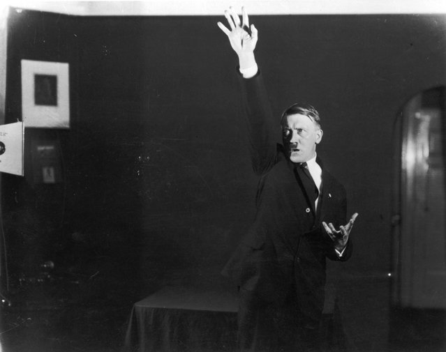 Adolf+Hitler+Posing+to+a+Recording+of+His+Own+Speeches+1925+11