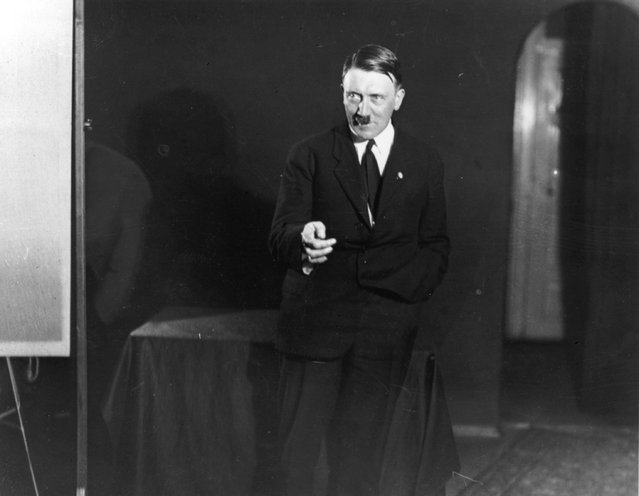Adolf+Hitler+Posing+to+a+Recording+of+His+Own+Speeches+1925+12