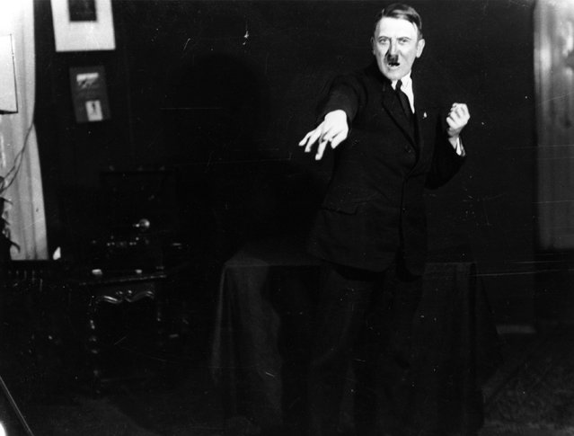 Adolf+Hitler+Posing+to+a+Recording+of+His+Own+Speeches+1925+6