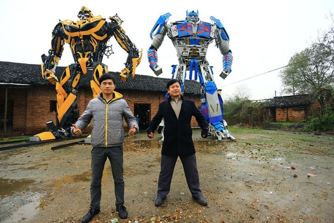 recycled scrap metal sculpture transformers father son farmer china 1