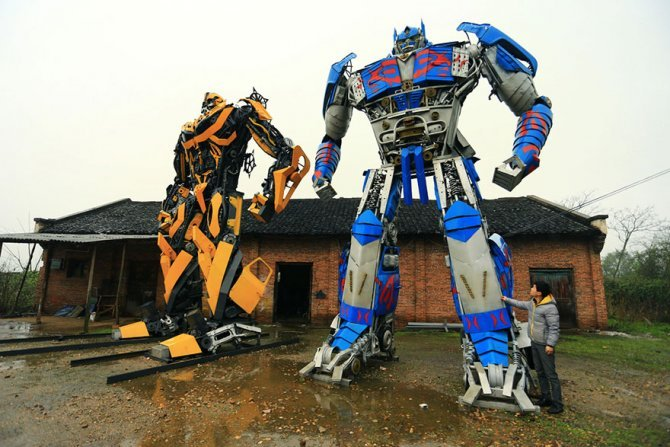 recycled scrap metal sculpture transformers father son farmer china 8