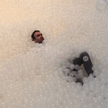 indoor-ball-pit-bubble-ocean-the-beach-snarkitecture-national-building-museum-gif-1